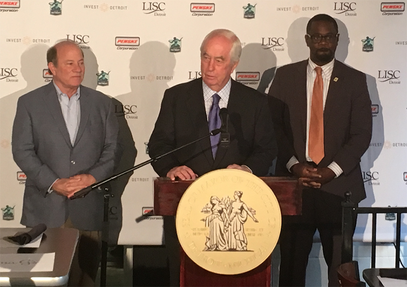 Mike Duggan, Roger Penske, and Andre Spivey