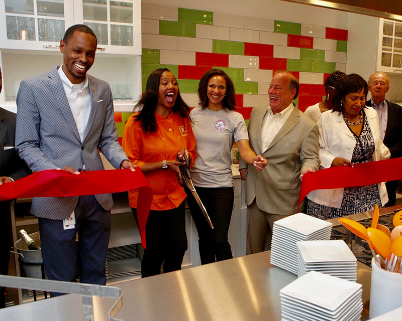 Quiana Broden and officials at the grand opening of The Kitchen, by Cooking with Que