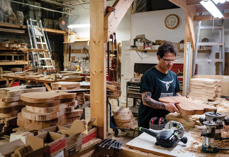 Gabriel Currie making a guitar
