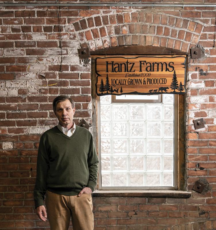 John Hantz by Hantz Farms sign