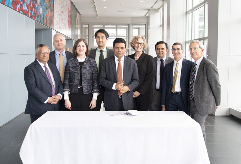 researchers from U-M with Anil Raghavan, CEO of Sun (fifth from the left)
