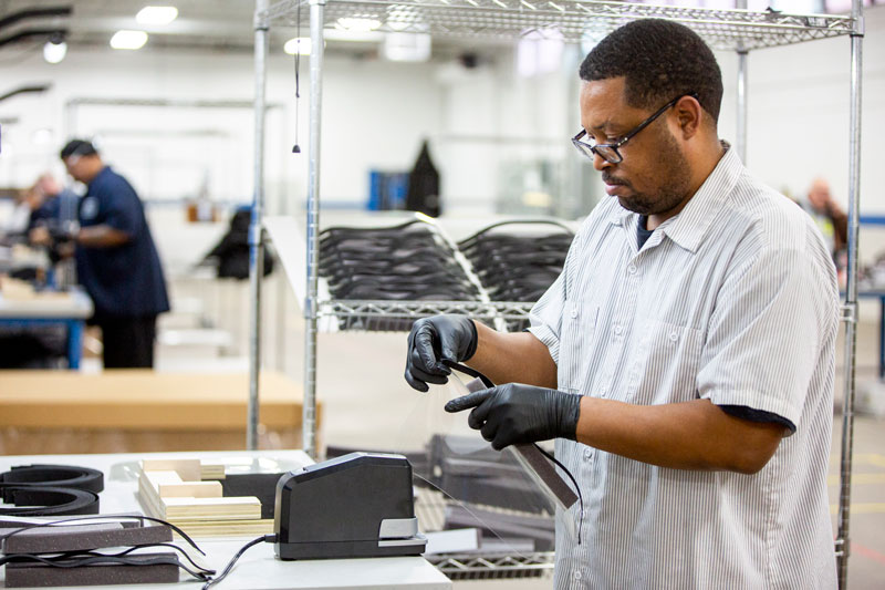 Ford employee making face shield