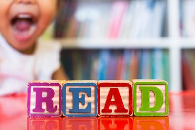 "alphabet block spelling ""READ"""